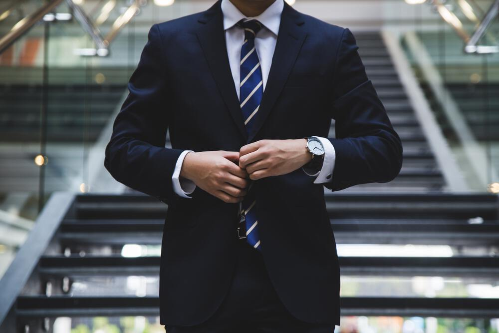 man in suit for article Murphys law of middle management